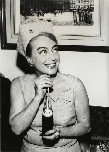 Joan Crawford sips pepsi through a straw. The star and widow of the Pepsi Chairman insisted on joining the Pepsi Board after his death.  Jingles and other stories of The American Dream. marchmaton.com