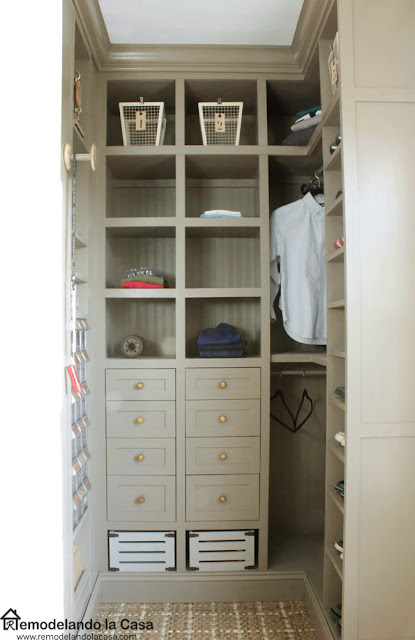 brown closet with built-ins and beadboard wallpaper