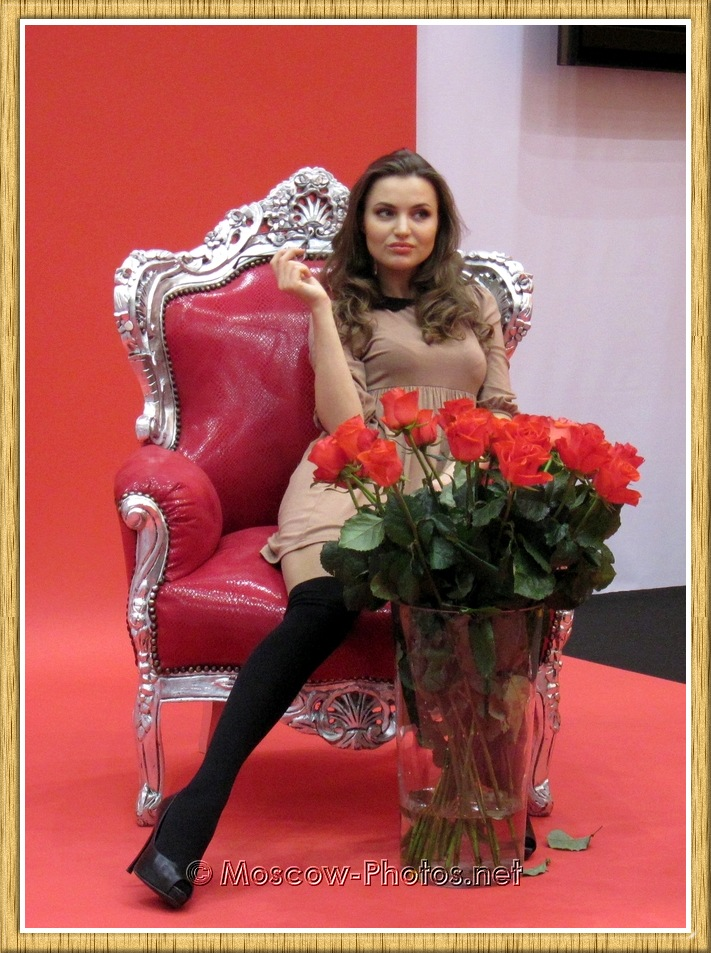 Model sitting on a red chair Photoforum - 2011