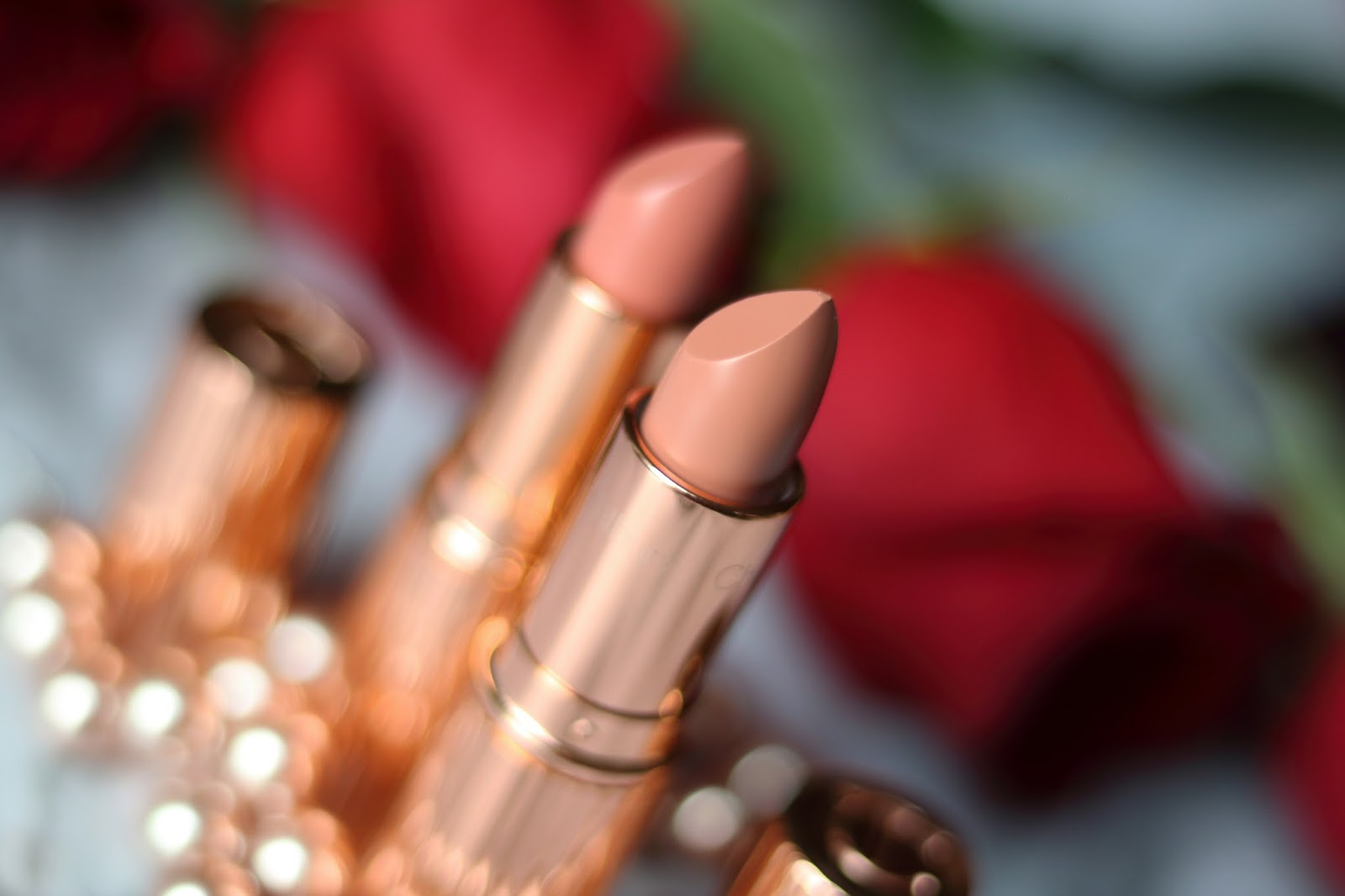 Charlotte Tilbury penelope pink bitch perfect swatch review kissing lipstick