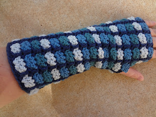 Crochet mitts, crochet fingerless gloves, crochet gauntlets pattern by April Garwood for Interweave Crochet