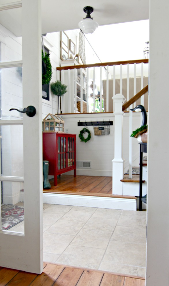 Split level entryway with DIY wall planking and chalkboard - www.goldenboysandme.com