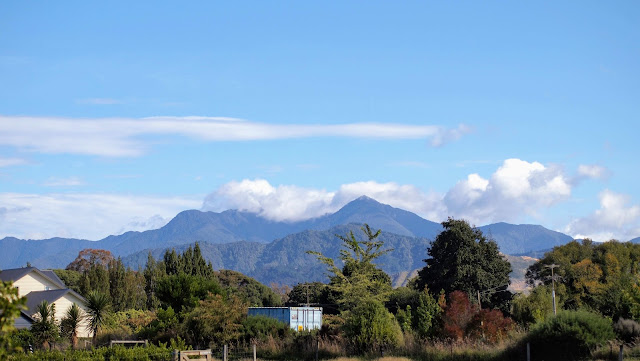 Clouds over the mountains near the Blenheim wineries in Marlborough New Zealand