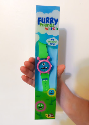 "The Furry Friends Watch in a box saying ""it's monster time"" and showing suitable for age 3 plus"
