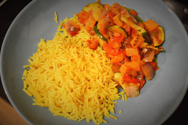 Ratatoullie and rice dish on a plate.