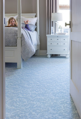 Light blue patterned carpet opens up the look and feel of this room.
