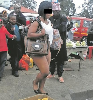 public in disgraced woman nude african