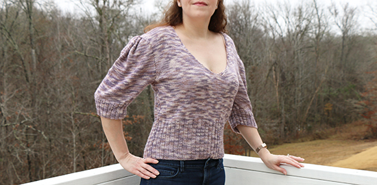 Front View of Hand-Knit Diamond Peplum Pullover in Light Purple