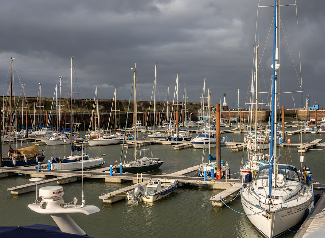 Photo of heavy skies and sunshine at Maryport Marina on Monday