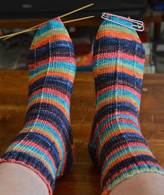 hand knit socks with a slip stitch pattern