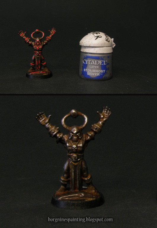 Photo showing the areas where the extreme metallic highlights should be applied, with a red overlay - in the most raised edges and points. A pot of Stormhost Silver paint is visible on the right.