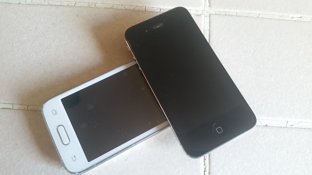 Still working two old model smartphones in white and black colors