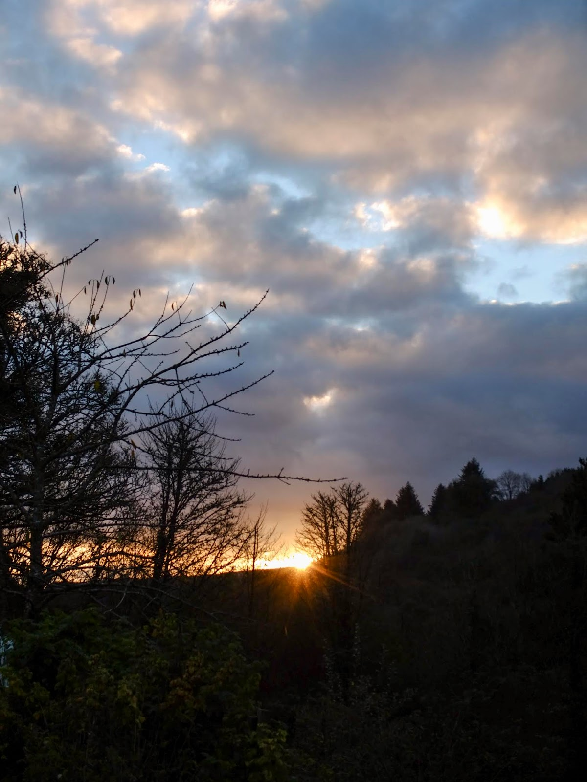 Sun going down behind a hill side in North Cork.