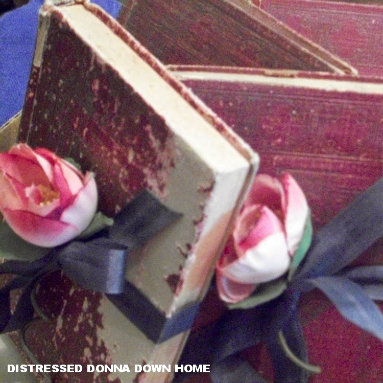 old books, decor with faux flowers