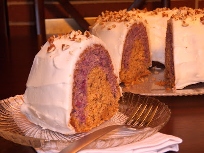 A slice Cranberry Orange Tunnel Bundt Cake in the foreground