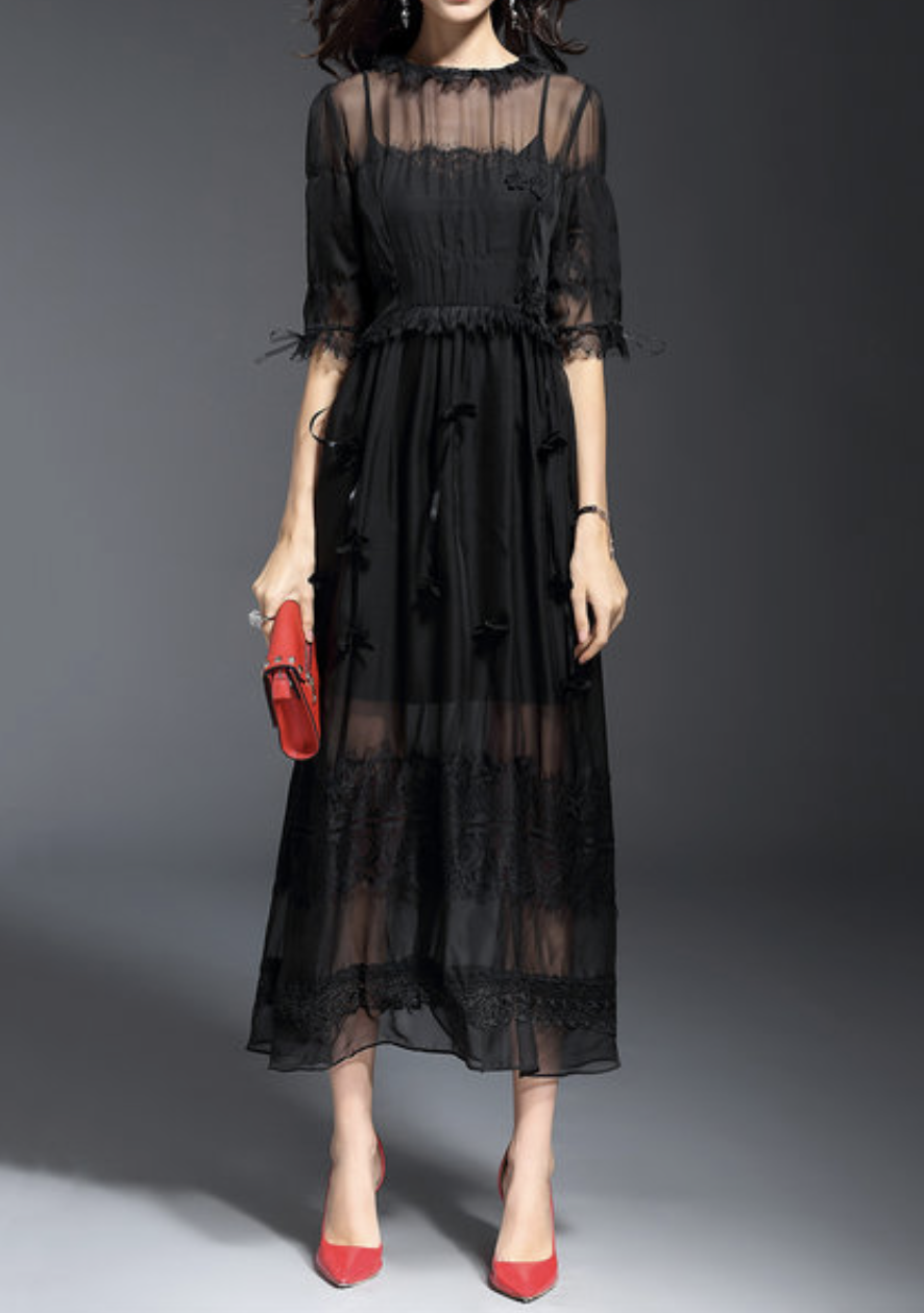 https://www.stylewe.com/product/black-elegant-mesh-paneled-plain-appliqued-maxi-dress-with-camis-95152.html