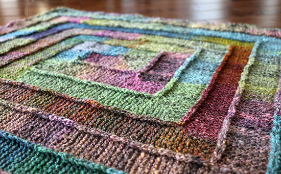 Angled View of Colorful Ten Stitch Wool Knit Rug