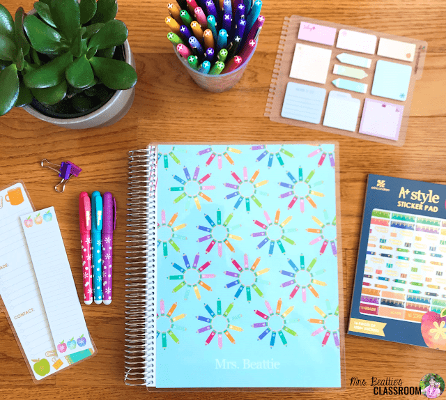Photo of Erin Condren Teacher Planner and accessories