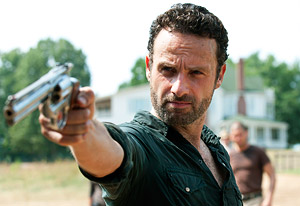Rick Grimes taking aim at Sophia as she emerges from the barn in Season 2.