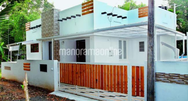Cute looking budget kerala 2 bedroom home design and plan for Low cost home plan