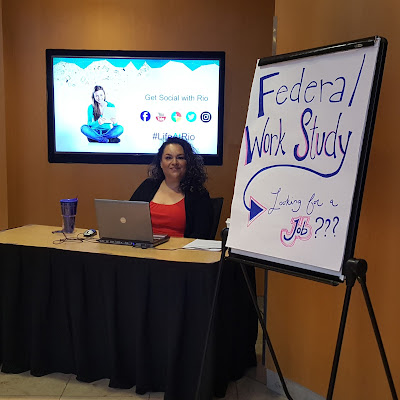 Image of Maribel Carlos at information booth, next to a sign that reads: Federal Work Study.  Looking for a job?