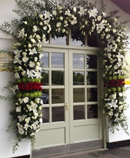 Floral arch at door weddings Suffolk