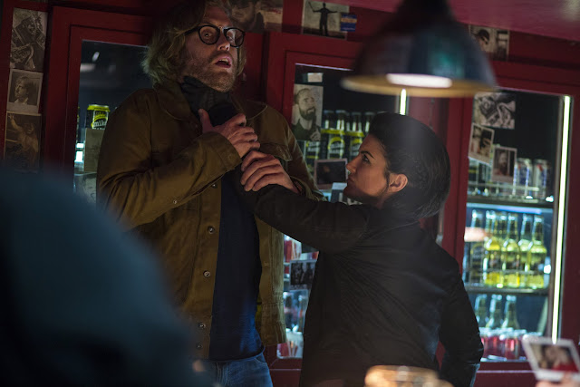 DEADPOOL Angel Dust (Gina Carano) roughs up barkeep Weasel (T.J. Miller), in DEADPOOL
