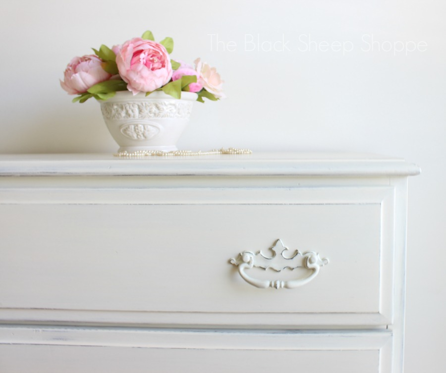 Drawer pulls painted in Old White with light distressing.