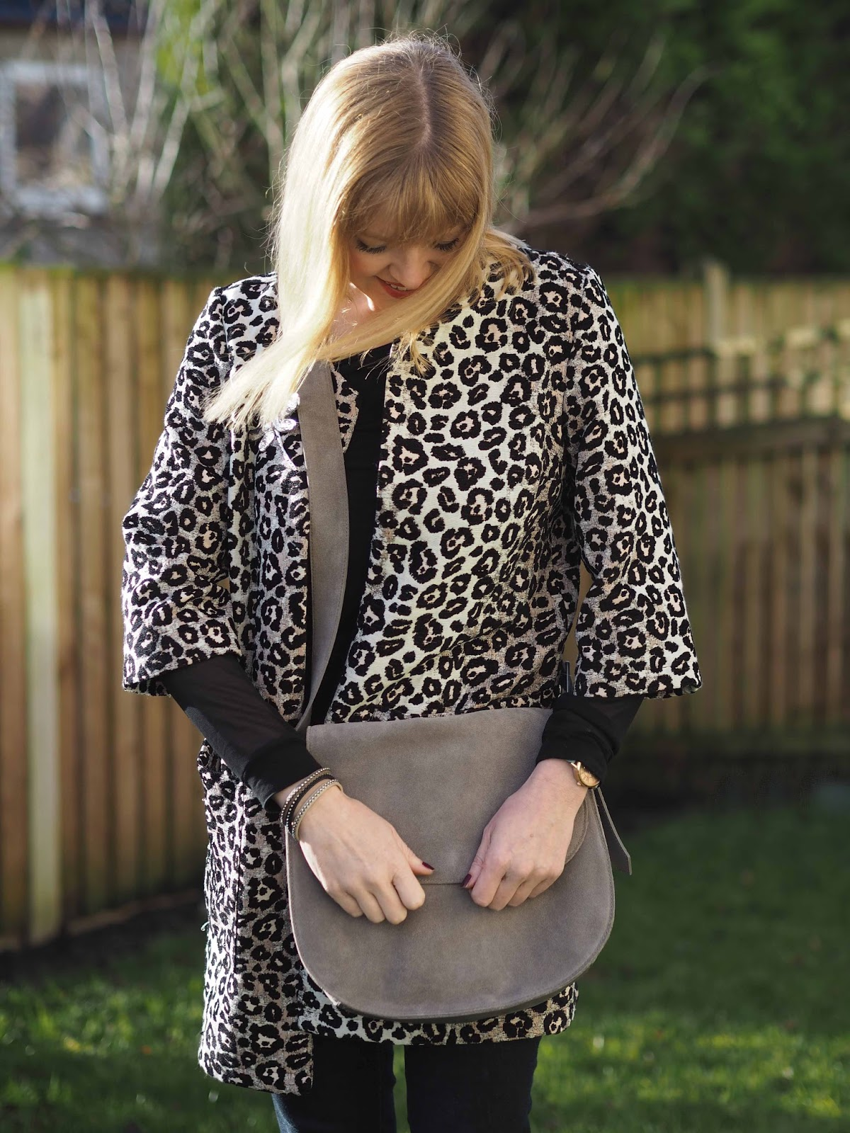 leopard print jacquard jacket with grey suede saddle bag, chelsea boots, large silver dragonfly brooch and crystal wrap bracelets