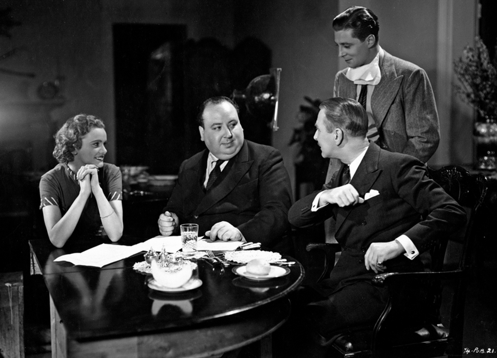 Nova Pilbeam, Alfred Hitchcock, Percy Marmont and Derrick De Marney (standing) on the set of Young and Innocent (1937)