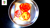 image of adding cucumber and tomato pieces on bread