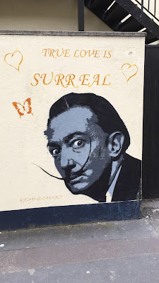 "Salvador Dali street art in Burnham-On-Sea with the caption, ""True love is surreal"""