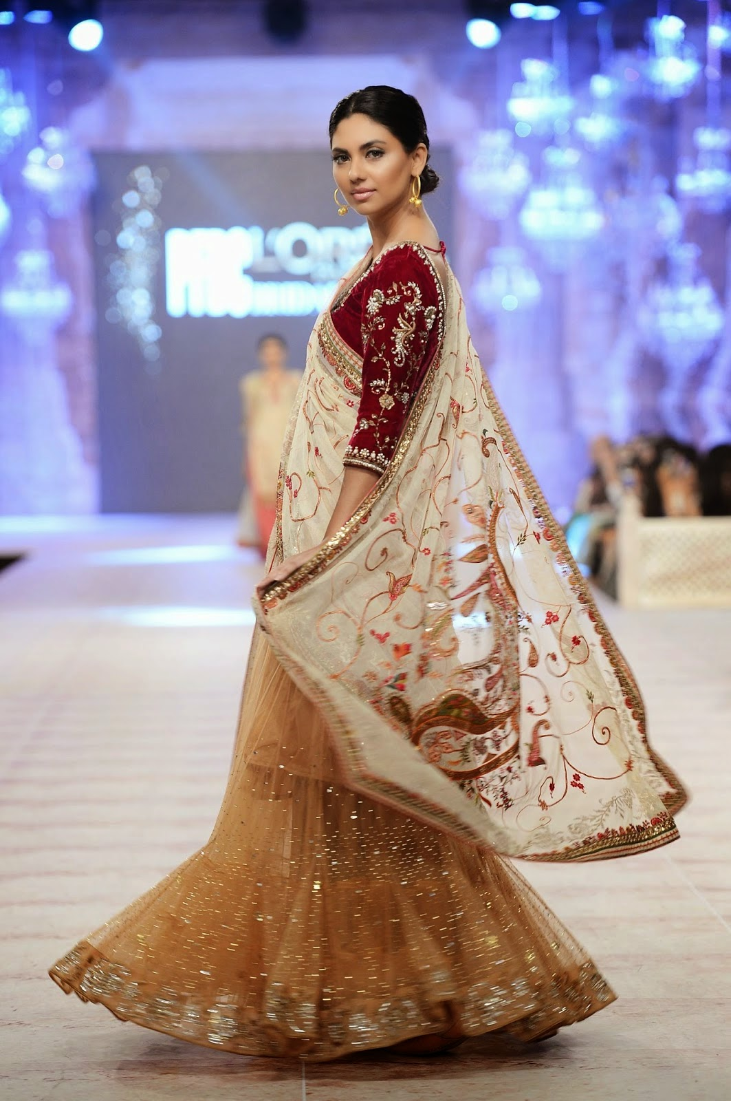 Maroon velvet choli with a gold lengha