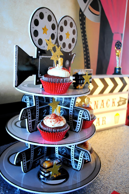 Add some movie props from Oriental Trading to your Oscar party. For more ideas head to www.fizzyparty.com