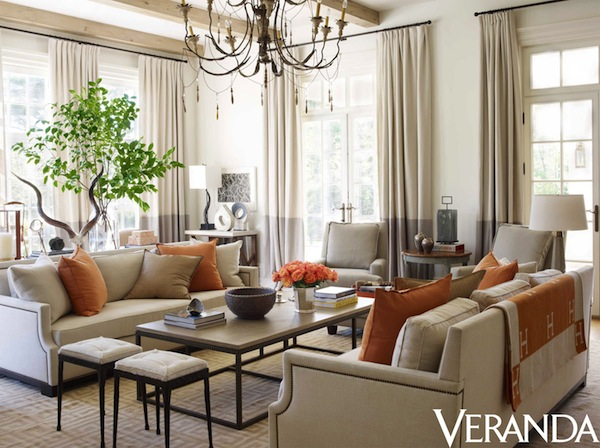 pop of color trend orange pillows in neutral living room