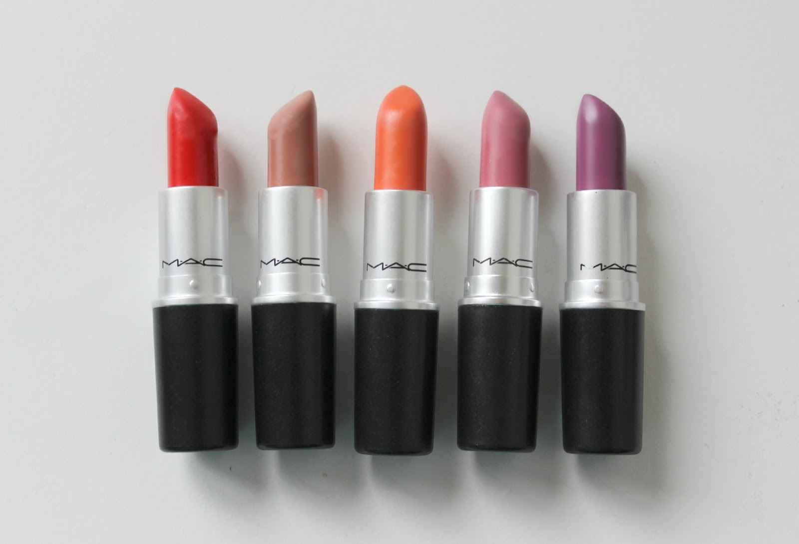 A picture of MAC lipsticks including Lady Danger, Honey Love, Saigon Summer, Pink Plaid and Up the Amp.