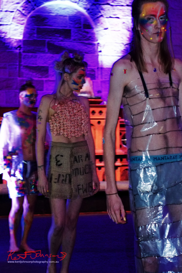 menswear from clear plastic, womans skirt from Hessian coffee bag, Barbie head halter-neck top. Raw to Recycled by Dehautt - Photographed by Kent Johnson.