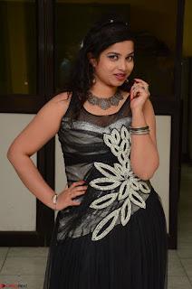 Shrisha Dasari in Sleeveless Short Black Dress At Follow Follow U Audio Launch 018.JPG
