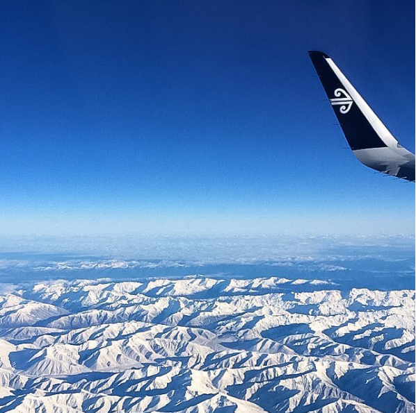 Airplane view over snowy New Zealand