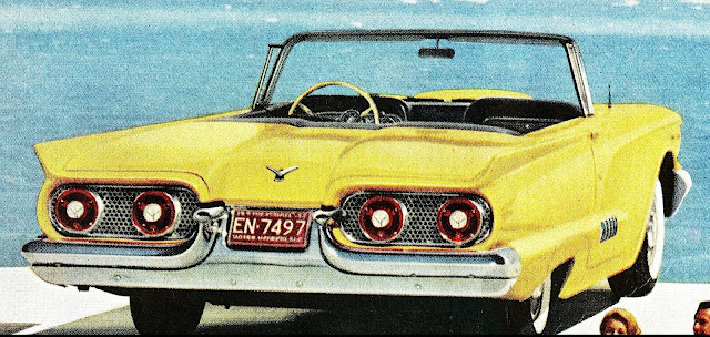 a yellow 1950s Ford Thunderbird color photograph