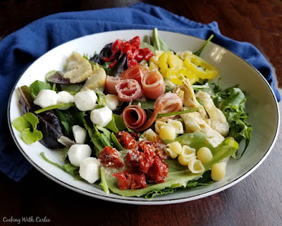 bowl of fresh salad with lots of great Italian toppers