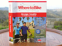 "Where to Bike Orange County is a first class biking guide packed with 321 pages of bike rides, for the recreational rider and family for locating bicycle routes through-out Orange County. There are 85 routes and 32 specially selected just for Kids. Published by BA Press, authored and photographed by avid cyclist Peter Dopulous. Peter writes ""Think of these rides as a network of interconnected bikeways and paths that would allow any cyclist to navigate the entire county by bike."" From the Authors Note Peter writes ""From  a cyclists point of view, Orange County is as close to bicycle nirvana as I have experienced. Although not every city is criss-crossed by bike lanes there are literally thousands of miles of bike lanes and paths. The cities of Irvine, Fullerton, Huntington Beach, Dana Point and San Clemente have invested considerable resources to developing comprehensive transportation plans that include cycling infrastructure.   Sounds too good to be true right? Despite the promising intro for Orange County, the attention to Laguna Beach is Let's have a look inside what"