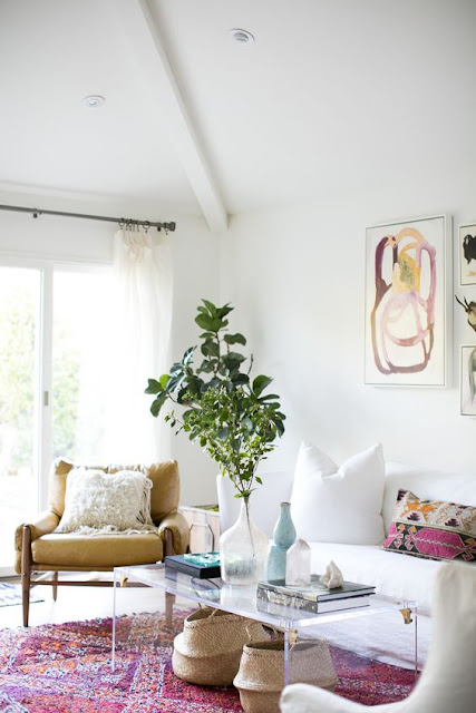 white wall living room pink rug
