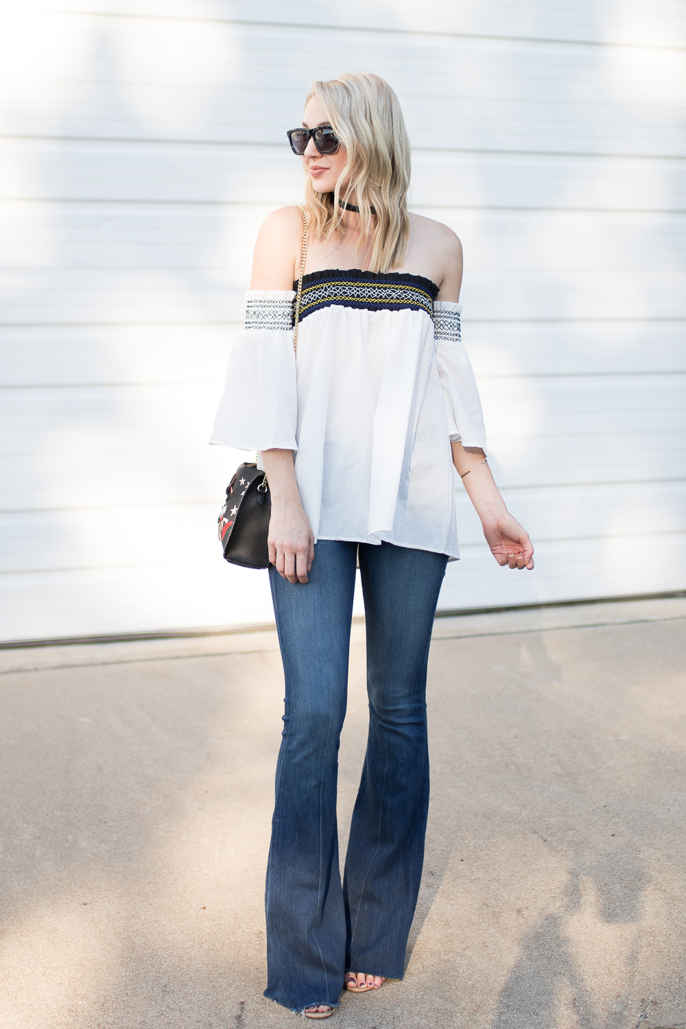 flare jeans with an off-shoulder top