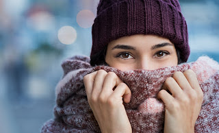 Woman in beanie and scarf