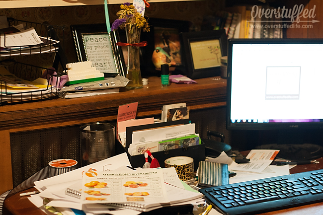 You have to ask some important questions in order to start tackling clutter problems like this messy desk.