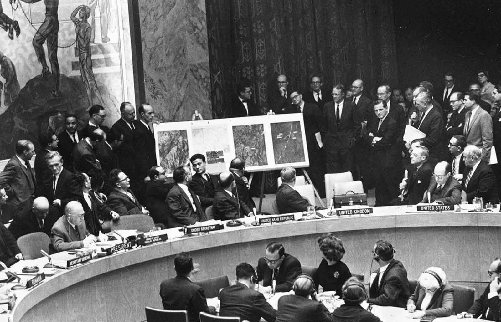 U.S. Ambassador to the United Nations, Adlai Stevenson, second from right, confronts Soviet delegate Valerian Zorin, first on left, with a display of reconnaissance photographs during emergency session of the U.N. Security Council at the United Nations headquarters in New York, on October 25, 1962.