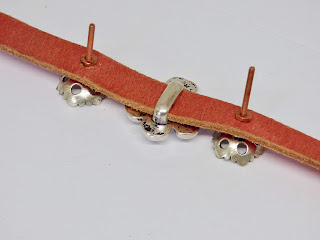 back of bracelet with nuts and screws
