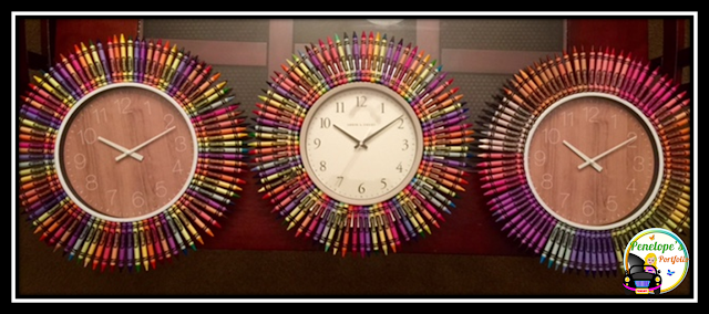 Three different cute and colorful clocks made with crayons on the outside of it