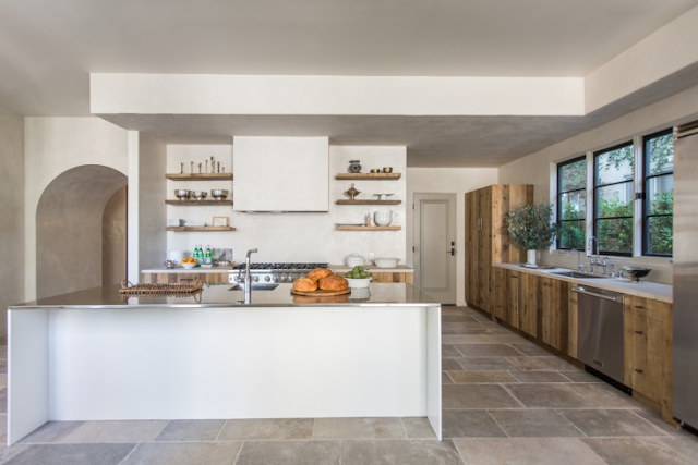 Beautiful kitchen in villa with European inspired interiors by Leigh Herzig - seen on Hello Lovely